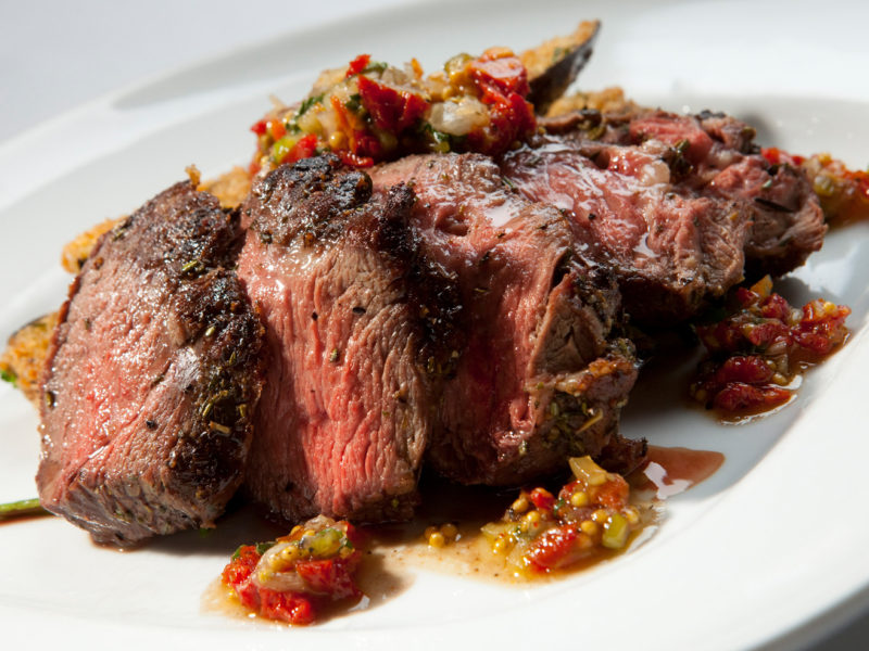 Rosemary Roasted Leg of Lamb with Sundried Tomato and Mint Relish